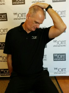 Todd Wegerski, Chiropractor at The Joint - Morrisville demonstrates the levator scapulae muscle stretch for neck pain.