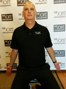 Todd Wegerski, Chiropractor at The Joint - Morrisville demonstrates Bruegger's Position for neck and upper back pain.